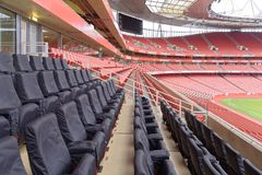 Empty sports stadium with red seats