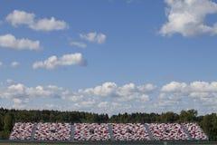 Empty sports tribune. Empty modern sports stadium tribune in front of blue sky background Royalty Free Stock Photos