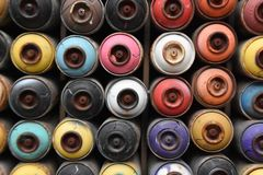 Empty spray cans, colorful stock image