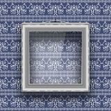 Empty square frame with glass on the wall with patterned wallpaper. Royalty Free Stock Image