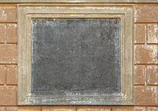 Empty square medallion on ancient wall royalty free stock photography