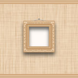 Empty square picture frame on a beige wall with fabric texture. Royalty Free Stock Photos
