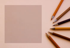 An empty square for the text with a brown pencil next Stock Images
