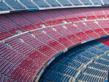 Empty Stadium. Rows of empty seats waiting for the audience Royalty Free Stock Images