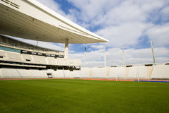 Empty Stadium. Empty Olympic Stadium and soccer field Royalty Free Stock Image
