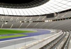 Empty Stadium. The Olympiastadion (Olympic Stadium) is a sports stadium in Berlin, Germany Stock Photo