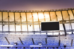Empty stadium with electronic billboard Royalty Free Stock Photography