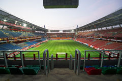 Empty stadium with footboll field after the game Stock Photography