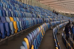 Empty stadium before the match with rows of seats a Royalty Free Stock Images