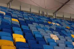 Empty stadium before the match with rows of seats a Stock Photography