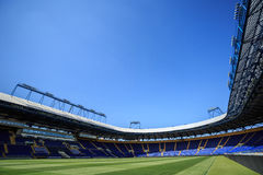 Empty stadium 'Metalist'. Panoramic view. KHARKIV, UKRAINE - JULY 29, 2014: Empty stadium 'Metalist'. Panoramic view from the corner of the pitch Royalty Free Stock Photos