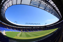 Empty stadium 'Metalist'. Panoramic view. KHARKIV, UKRAINE - JULY 29, 2014: Empty stadium 'Metalist'. Fish-eye view from the corner of the stands Stock Photography