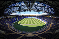 Empty stadium 'Metalist'. Panoramic view. KHARKIV, UKRAINE - JULY 29, 2014: Empty stadium 'Metalist'. Fish-eye view of the whole stadium from the stands Royalty Free Stock Photos