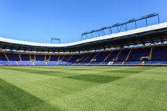 Empty stadium 'Metalist'. Panoramic view. KHARKIV, UKRAINE - JULY 29, 2014: Empty stadium 'Metalist'. Panoramic view from the pitch Stock Image