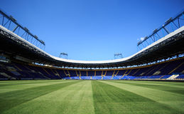 Empty stadium 'Metalist'. Panoramic view. KHARKIV, UKRAINE - JULY 29, 2014: Empty stadium 'Metalist'. Panoramic view from the pitch Stock Images