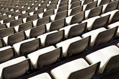 Empty stadium seats. In multiple rows Stock Images