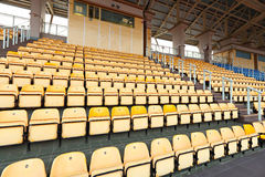 Empty stadium seats. In yellow color Royalty Free Stock Photo