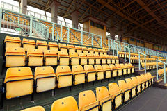 Empty stadium seats. In yellow color Royalty Free Stock Photos