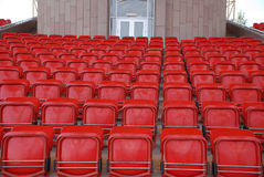 Empty Stadium Seats. Red color perspective Royalty Free Stock Photo
