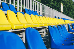 Empty Stadium Seats. Blue and yellow empty stadium seats in school n Royalty Free Stock Photos
