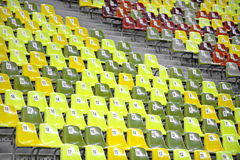 Empty Stadium Seats. Empty stadium colored seats with nocturne lights reflections Royalty Free Stock Image