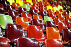 Empty Stadium Seats At Night. Empty stadium colored seats with nocturne lights reflections Royalty Free Stock Images