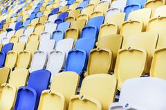 Empty stadium seats. With the raised lids Royalty Free Stock Image