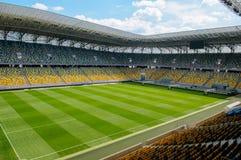 Empty stadium in sunlight. Empty stadium soccer field with tribune in sunlight Royalty Free Stock Photography