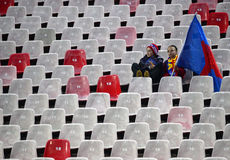 Empty Stadium Tribune. Two little girls, fans of Steaua Bucharest, are pictured in the stands during the Romanian League 1 game between Steaua Bucharest and FC Royalty Free Stock Photos