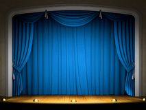 Empty stage with blue curtain. In expectation of performance Stock Image