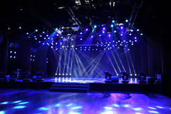 Empty stage in blue light beam Stock Images