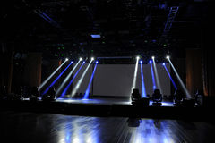 Empty stage in blue light beam. An empty stage in blue and white light beam Royalty Free Stock Photos