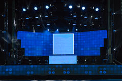 Empty Stage with Blue Lights and Black Ceiling Royalty Free Stock Photography