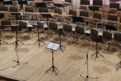 Empty stage with chairs, microphones and music stands before the Royalty Free Stock Photo
