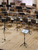 Empty stage with chairs, microphones and music stands before the Stock Photography