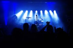 Empty Stage at concert. Concert crowd in front of bright stage lights Royalty Free Stock Image