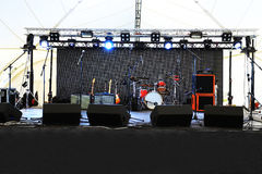 An empty Stage Before the Concert. With floodlight and musical instruments Royalty Free Stock Photos