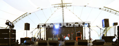 An empty Stage Before the Concert. With floodlight and musical instruments Stock Photo