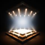 Empty stage illuminated by spotlights. Stock Photos
