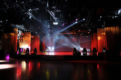 Empty stage in light. An empty stage in colorful light beam Royalty Free Stock Photos
