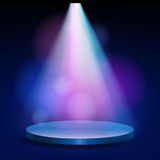 Empty stage lit with lights on blue background. On the podium shines a bright spotlight Stock Photo