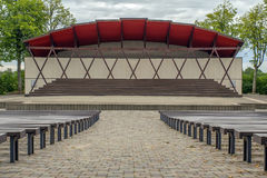 Empty stage and many benches. Open air empty stage in small town,cobbled floor Stock Images
