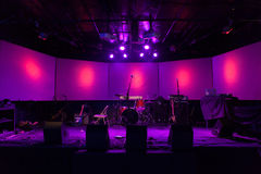 Empty stage. With music equipment and pink lights on the walls royalty free stock image