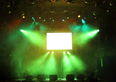 Empty stage in the rays of light. Empty stage and screen in the rays of light concert Stock Photos