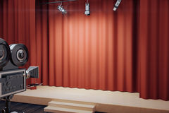 Empty stage with red scenes, spotlights and vintage movie camera. Close up Stock Image