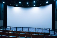 Empty stage in the small movie theater with white screen. Empty stage in the small movie theater with white isolated screen stock photo