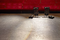 Empty Stage With Spotlights And Seats. View of an empty stage with spotlights and red seats Royalty Free Stock Photos