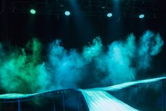 Empty stage with steam. Light beam at the empty stage with steam royalty free stock image