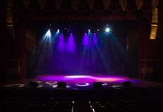 An empty stage of the theater, lit by spotlights and smoke Stock Image