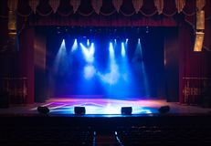 An empty stage of the theater, lit by spotlights and smoke. Before the performance royalty free stock images